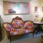 An example of our own parents' collection: Hunt Slonem upholstered Victorian sofa; Robert Natkin, Jimmy Ernst & Byron Browne paintings; a Pairpoint cut glass lamp and French brass lamp.