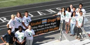 """LHS CORE students with their """"Friday Night Done Right"""" banner."""