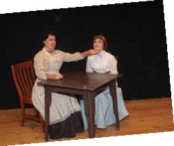 Sharon True as Mrs. Webb consoles her on-stage daughter, Emily Webb, played by Brigid Wallace.