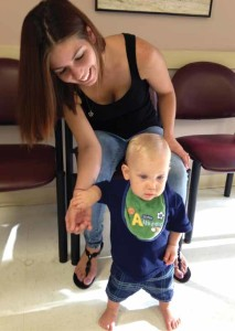 Megan Murphy and her son James share a light moment in the waiting room at Healthcare Network of Southwest Florida Children's Care Central clinic.