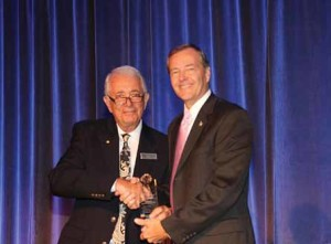 Dr. Frank Nappo, Board President presents Sheriff Kevin Rambosk with award.