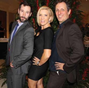 Comedians Nigel Lawrence and Jake Johannsen strike a pose with emcee Krista Fogelsong
