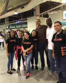 MEMBERS OF LELY HIGH SCHOOL'S CORE SOCIETY POSE WITH DRUG FREE COLLIER'S COMMUNITY AMBASSADOR, IKE ALAMA-FRANCIS AND DAVID JONES, PRESIDENT OF ATHLETES AGAINST BULLIES. Photo Credit: ALBERTO DELEON